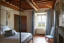 08 Here's one of the bedrooms with an amazing canopy bed and blue textiles
