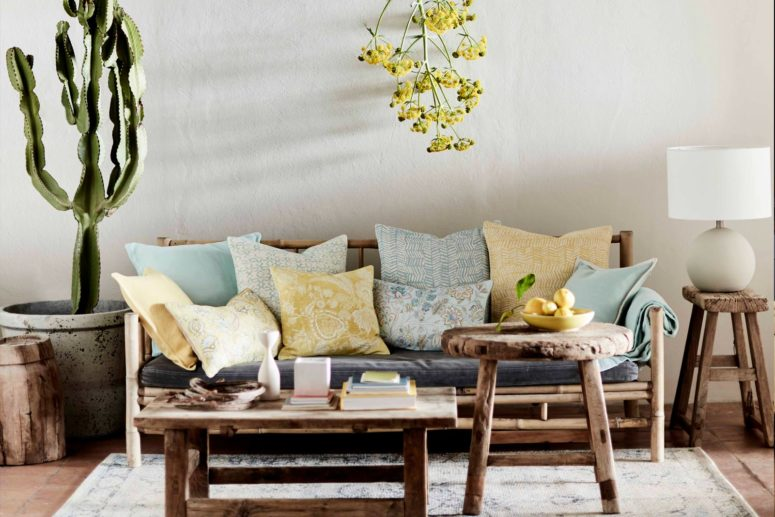 The pillows are done in blue and mustard yellow with subtle prints