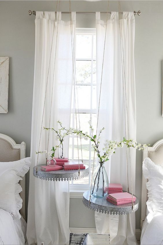 a couple of hanging metal bedside tables for a sweet vintage guest bedroom
