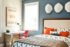 08 a guest bed and a home office are tied with the use of orange, which makes the space cool