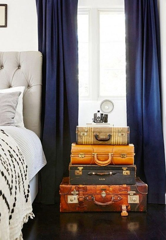 a stack of vintage suitcases adds color and interest to the bedroom making it more special