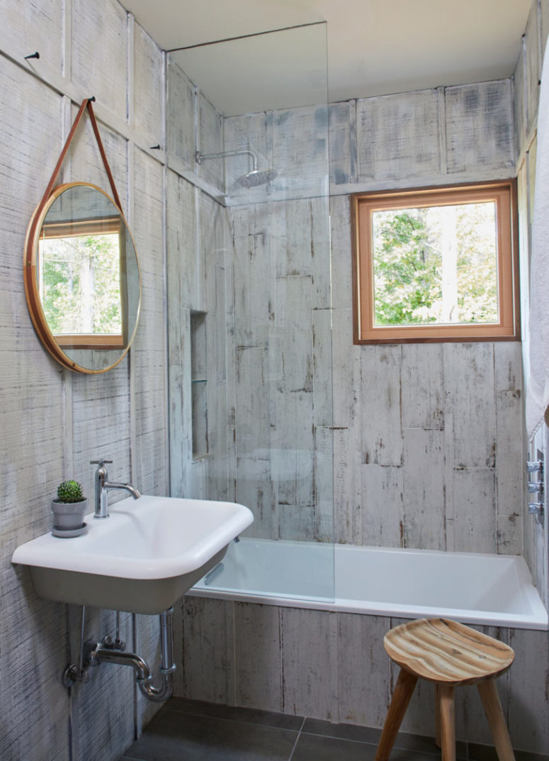 The guest bathroom is done with whitewashed reclaimed wood and vintage appliances