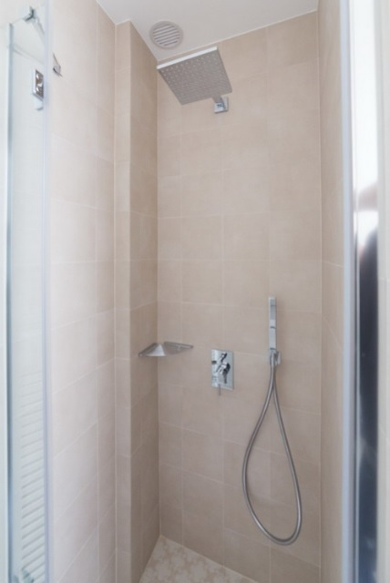 The shower is small but still enough for a person
