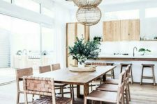 09 a boho beach dining space with wicker furniture and pendants looks very fresh and modern