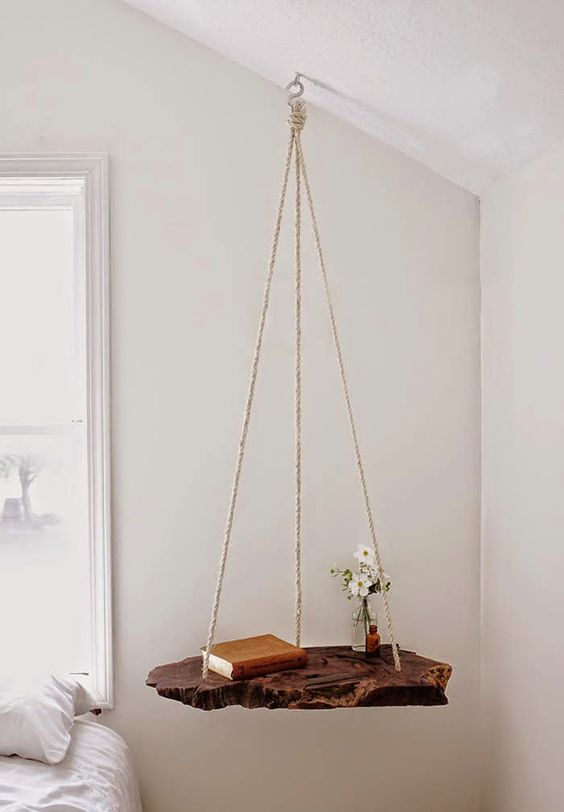 a creative nightstand of rope and a raw wood piece for a natural touch in the bedroom
