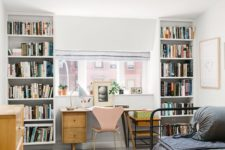 09 a guest bedroom with a home office space with bookcases and a wooden desj by the window for comfortable working