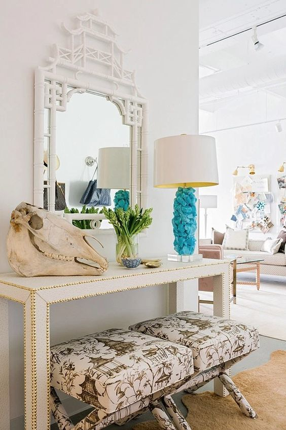 a hammered console, a skull, greenery and a creative blue rock lamp for a bright touch
