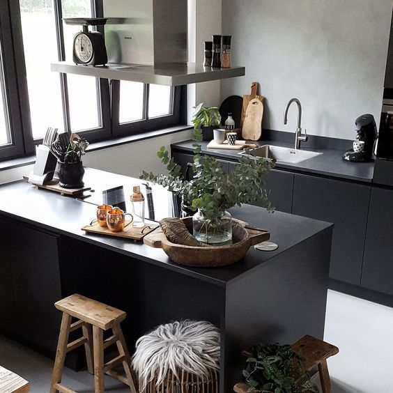 grey plaster wall with black sleek cabinets for an ultra modern Scandinavian kitchen
