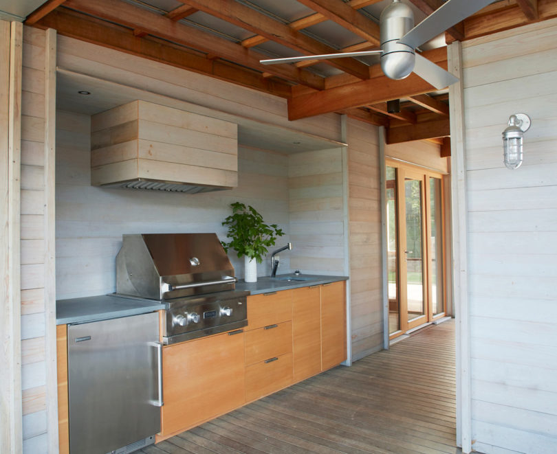 cool outdoor kitchen that features reclaimed wood