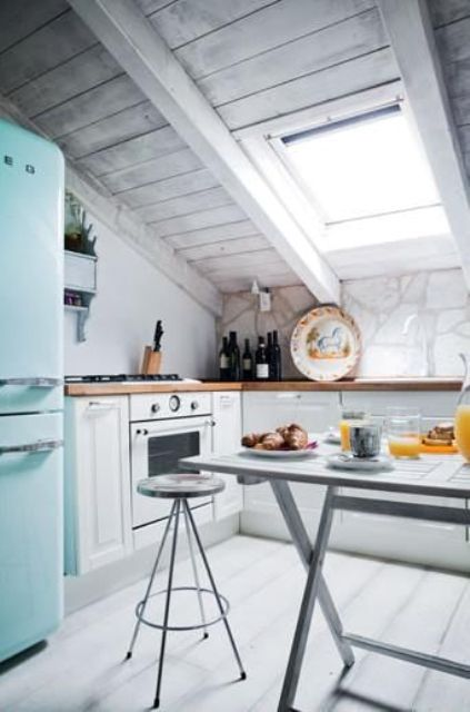 a whitewashed kitchen inspired by the beaches and with skylights instead of windows