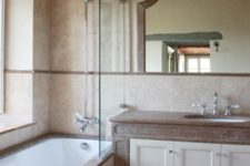 11 The bathroom is done in neutrals and fully modernized for more comfort