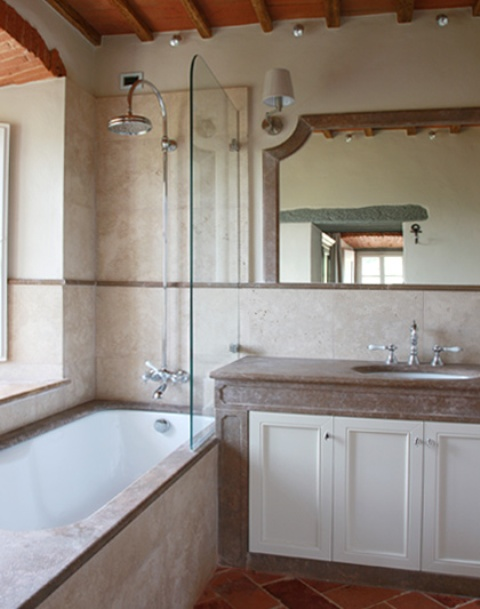 The bathroom is done in neutrals and fully modernized for more comfort