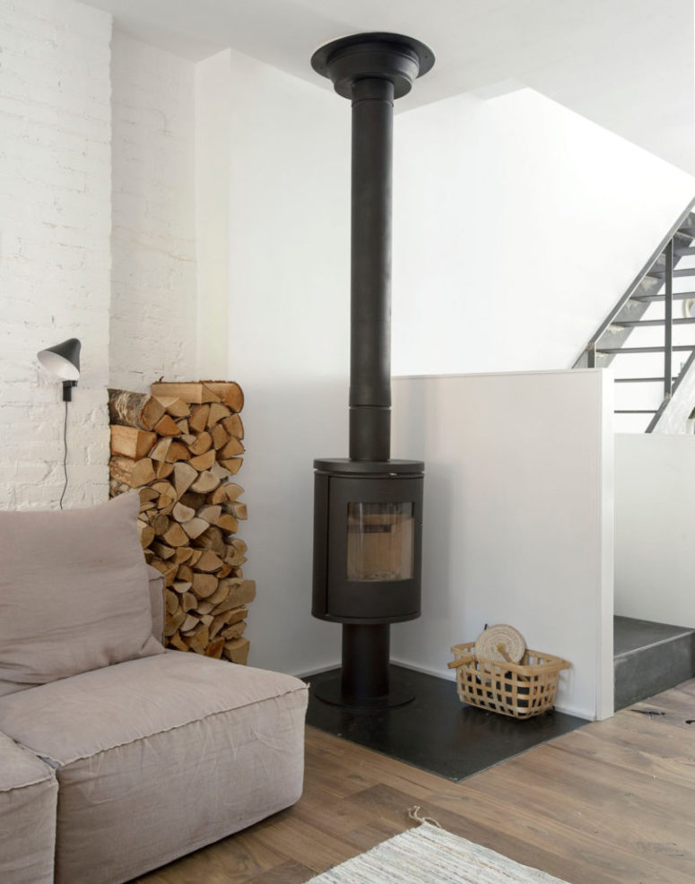 There's a hearth with firewood storage, which adds coziness to the space, too