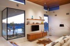 11 a sunken living room with a view and a cozy feeling is all you need after a hard day