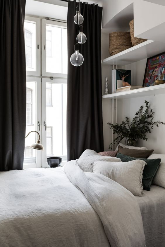 if there's a large window, some pendant lamps right over the bed are enough