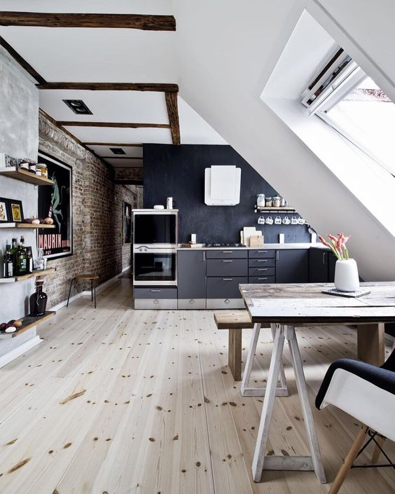 a Scandinavian black and white space with lots of skylights that bring light in and much wood for coziness