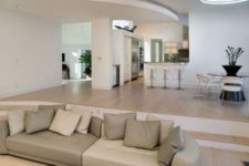 12 a sunken living room is visually separated yet not too much and the space feels larger