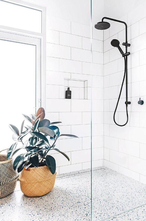 a tall window placed on the side and with potted plants to make the shower more private