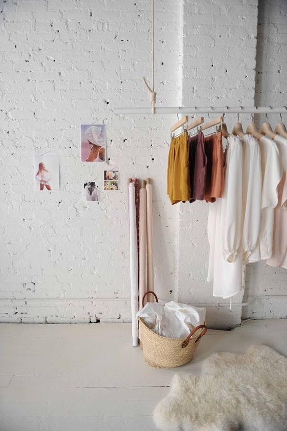 an ethereal girlish space with a hanging rack of rope and a tube for an airy look