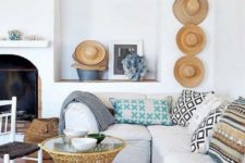 straw hats, a rattan pendant and a rattan table make the beach house cooler