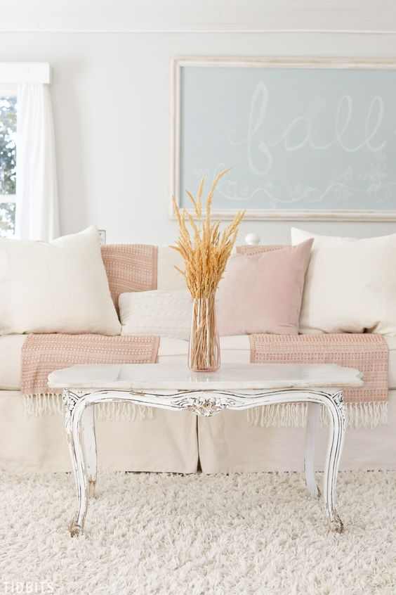 a chic living room with touches of blush and powder blue for a touch of color