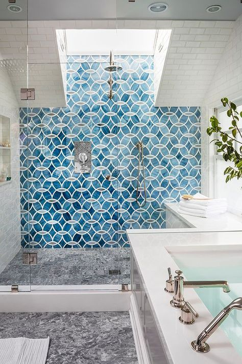 a chic shower with mosaic tiles and a skylight for much light yet full privacy