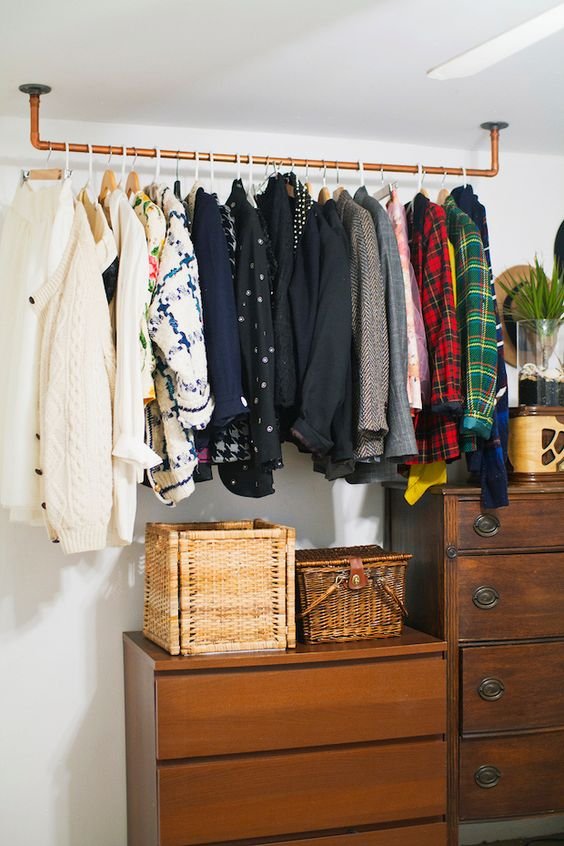 a copper rack attached to the ceiling is always a great idea and it can hold a lot of things