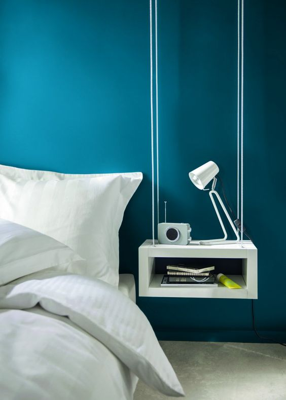a hanging modern bedside table of a box features open storage and a laconic look