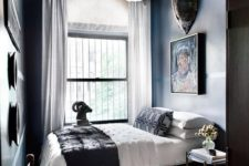 14 a large and bold chandelier makes a statement in this moody lux guest bedroom