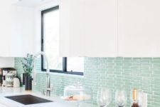 14 a minimalist kitchen with an aqua tile backsplash is a fresh take on a coastal kitchen