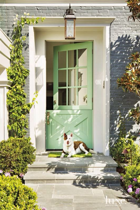 spruce up the entrance with a bright green Dutch door and a grass-style mat