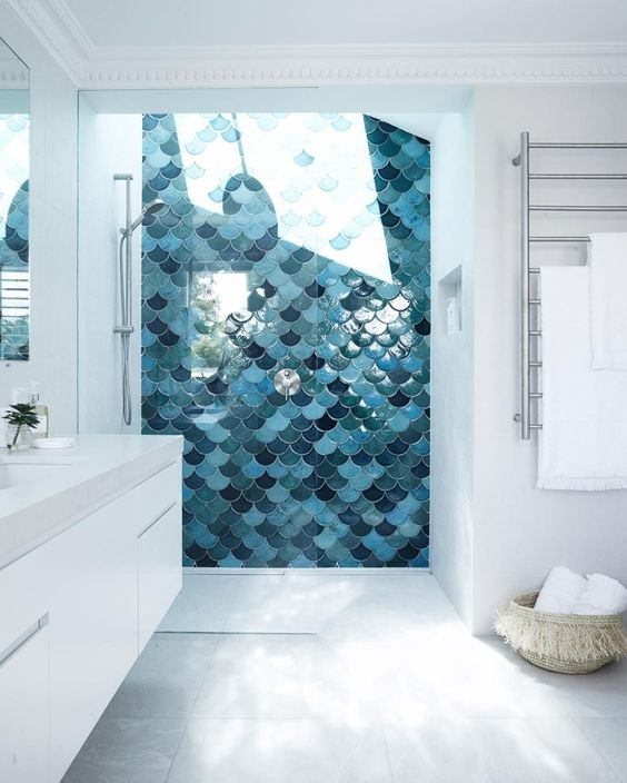 the shower done with fish scale tiles and a skylight makes showers a spa experience while keeping them private