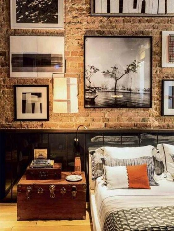 a vintage wooden trunk adds personality to this industrial masculine bedroom