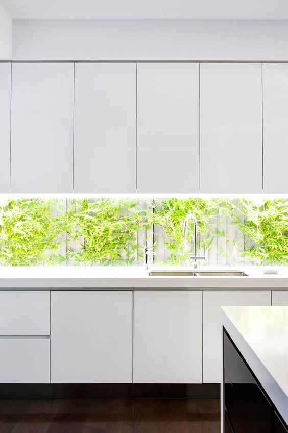 an all white look could be boring if not a window backsplash with much greenery in the yard