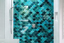 mermaid-inspired tiles in the shower will remind you of the sea and swimming in it