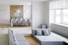 16 a minimalist sunken living room with geometric furniture and a view