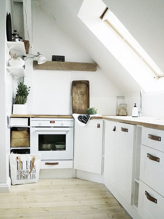 a small contemporary kitchen with rustic wooden touches and a skylight instead of a window