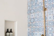 16 blue mosaic tiles and copper fixtures will make your shower very coastal-like