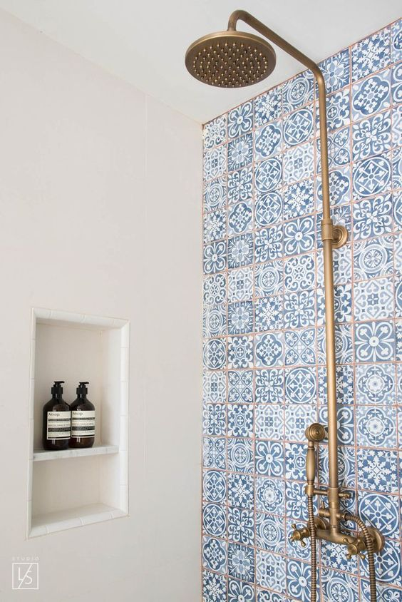 blue mosaic tiles and copper fixtures will make your shower very coastal-like