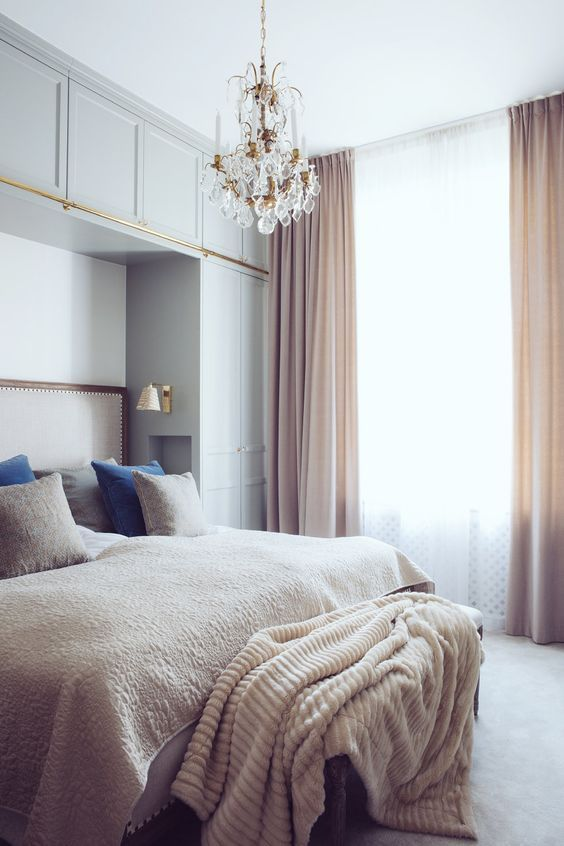 light blue cabinets and blush curtains to make the bedroom more interesting and welcoming