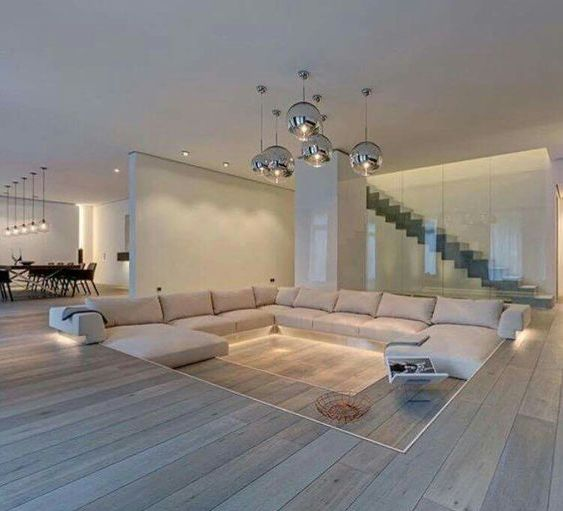 a minimalist sunken living room to separate it bisually and make the space feel cozier