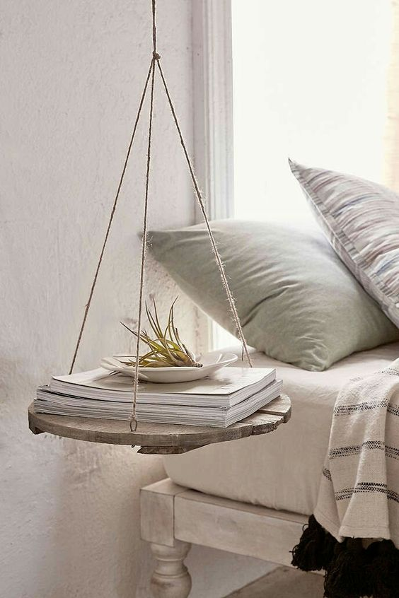 a rustic hanging nightstand of rope and a wood piece for a rustic vintage bedroom