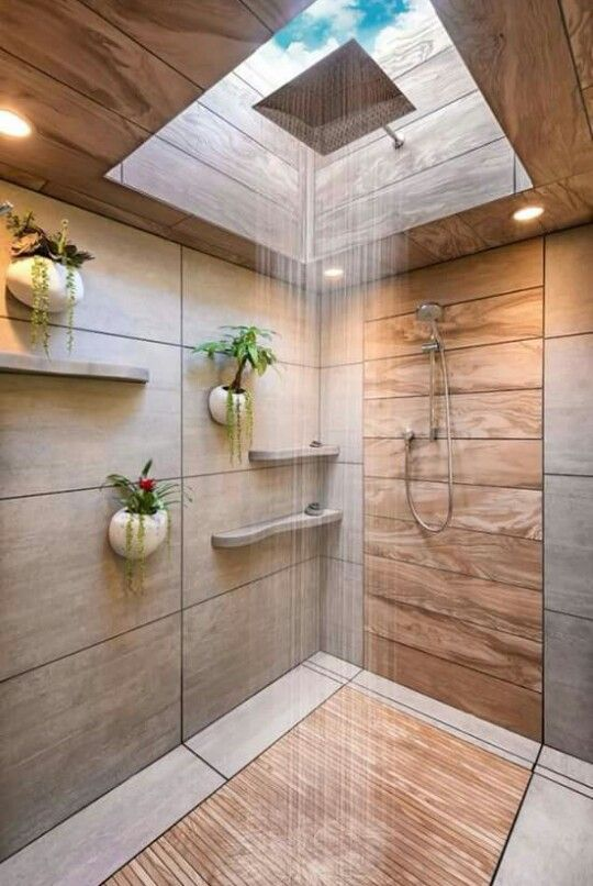 a shower done with wood and stone plus a skylight creates a very natural feel while taking a shower