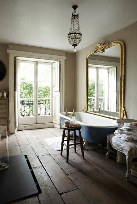 placing a mirror next to the bathtub is gorgeous but you'll have to dust and clean it after every bath