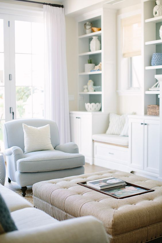 powder blue chairs and touches of this color here and there adds interest to the space
