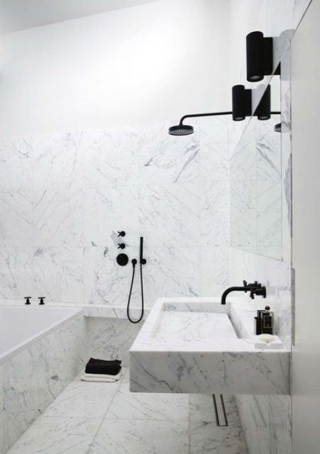 white marble tiles plus black fixtures for a bold modern look in the bathroom