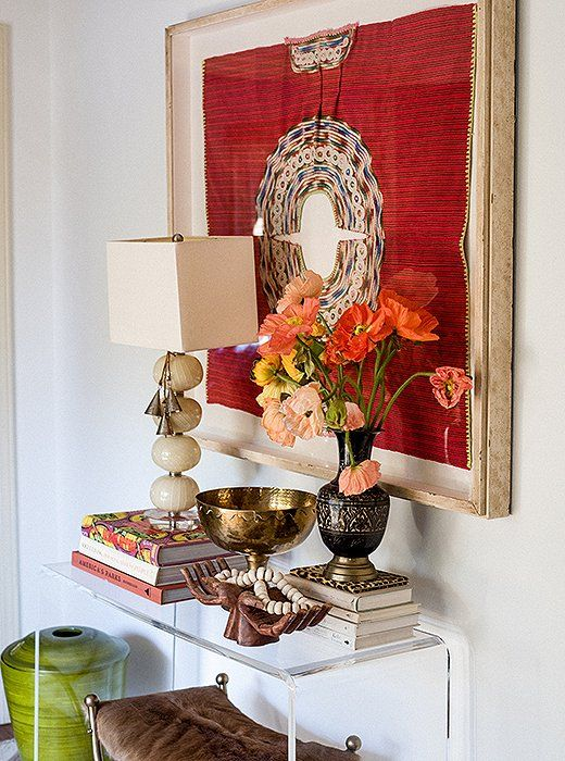 a bold artwork, bright blooms, some finds from trips for an inspiring entryway