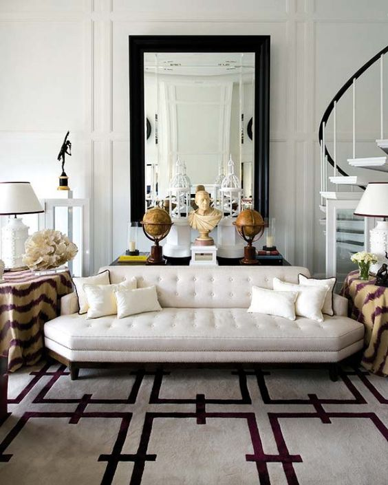 a luxurious off-white couch with geometric lines doesn't look boring at all