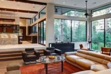 18 a mid-century modern sunken living room with elegant furniture and much light coming through windows
