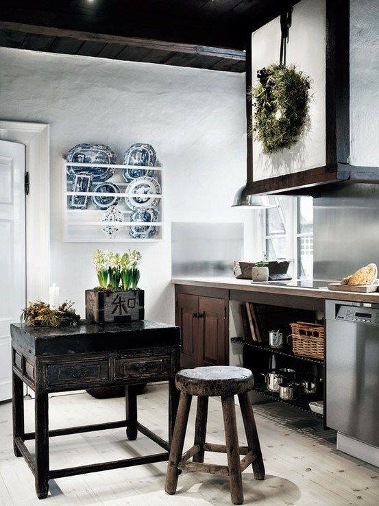 white plaster walls make dark cabinets stand out for a bold modern meets traditional look